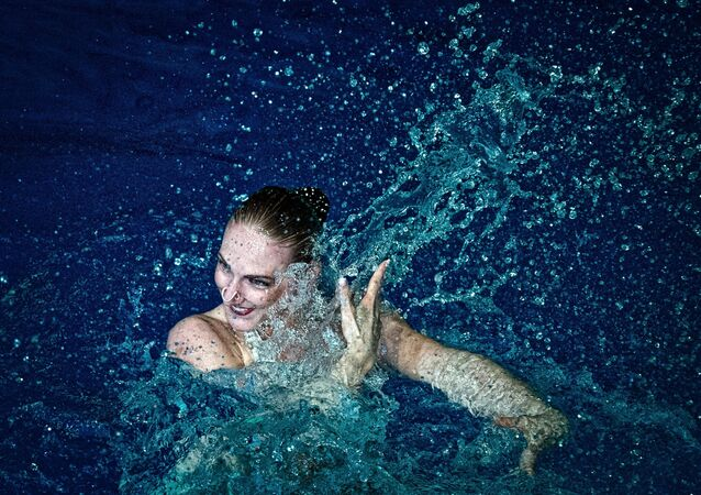 Synchro swimmer Svetlana Romashina during a show at Olimpiysky Arena given by Olympic champions in synchronized swimming