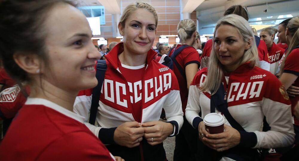 Members of the Russian Olympic handball team Polina Kuznetsova and Vladlena Bobrovnikova (right to left) at Sheremetyevo Airport