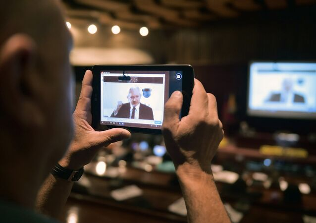People attend a video conference of WikiLeaks founder Julian Assange at the International Center for Advanced Communication Studies for Latin America (CIESPAL) auditorium in Quito on June 23, 2016