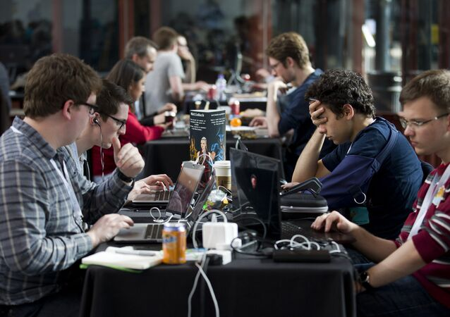 Participants work on laptops as they take part in a Battlehack competition in London on April 25, 2015