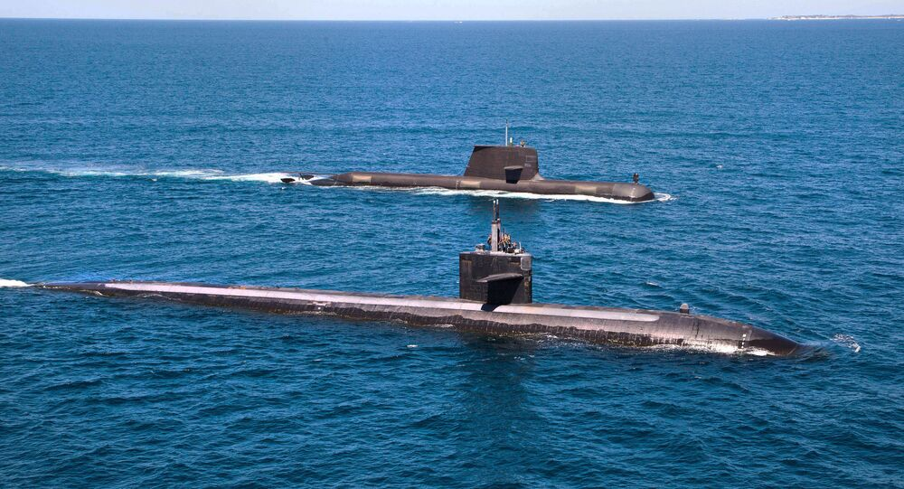 The U.S. Navy's Los Angeles-class fast attack submarine USS Albuquerque (SSN 706) and Royal Australian Navy Collins-class submarine HMAS Rankin (SSG 78) operate together in waters off Rottnest Island, Western Australia.