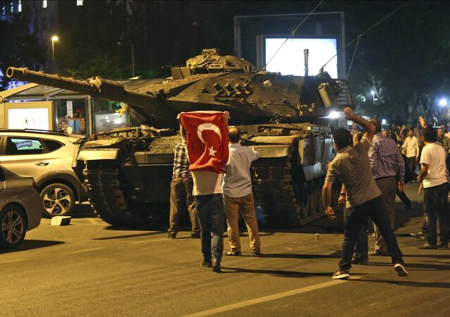 A tank moves into position as Turkish people attempt to stop them, in Ankara, Turkey, early Saturday, July 16, 2016
