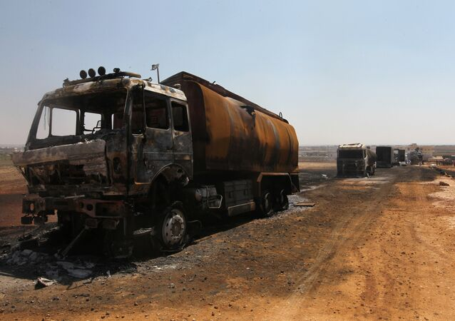 Damaged trucks are pictured after an airstrike on a truck parking lot in the rebel-held town of Atareb in Aleppo province, Syria August 3, 2016