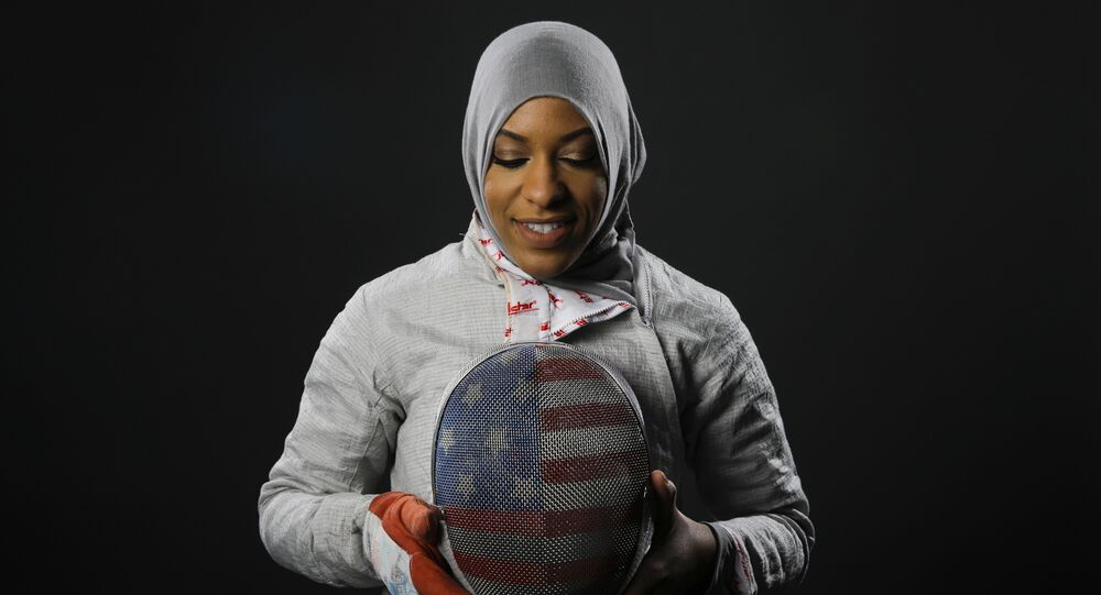 In this March 8, 2016, file photo, Fencer Ibtihaj Muhammad poses for photos at the 2016 Olympic Team USA media summit in Beverly Hills, Calif.