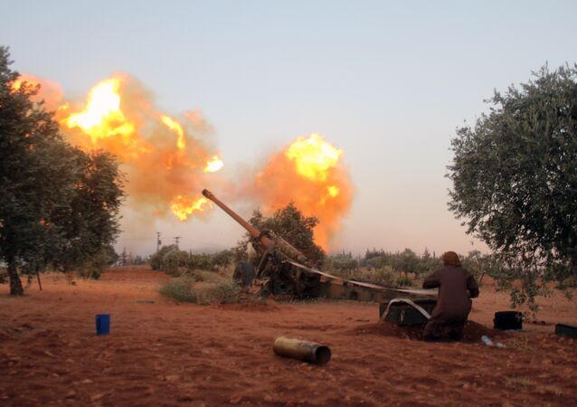 Opposition fighters, belonging to Ajnad Al-Sham, fire shells from their position in Aleppo's southern countryside (File)
