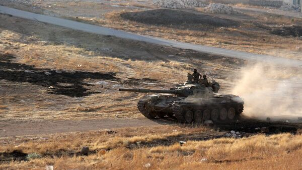 Opposition fighters drive a tank in the Al-Huweiz area on southern outskirts of Aleppo as they battle to break the government seige on the northen Syrian city on August 2, 2016 - Sputnik International