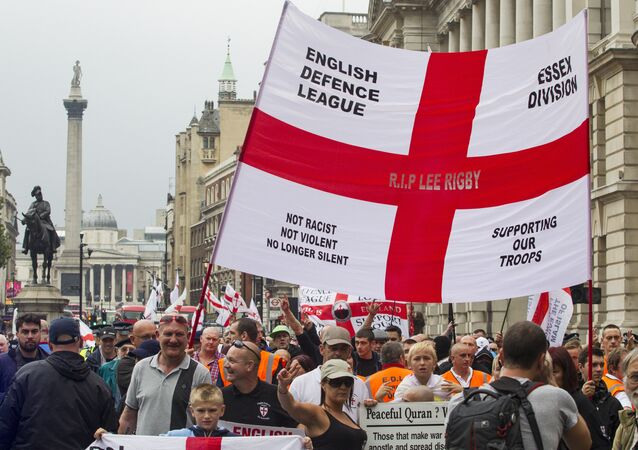 Supporters of the far-right English Defence League (EDL) display banners and flags take part in a march in London on September 20, 2014
