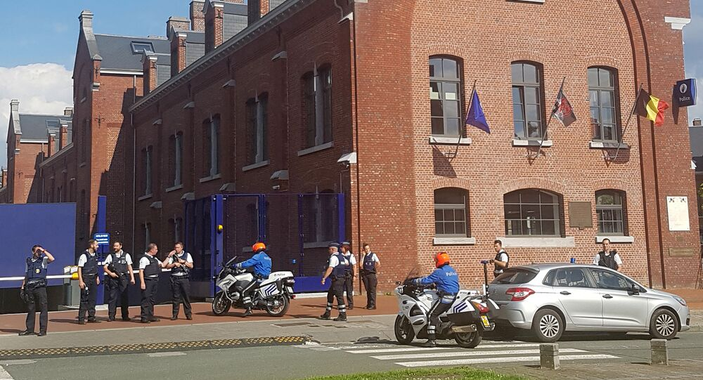 A photo taken with a mobile phone on August 6, 2016, shows police securing the area around a police building in the southern Belgian city of Charleroi following a machete attack