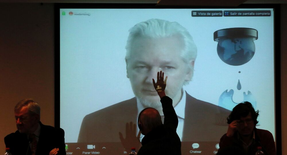 WikiLeaks founder Julian Assange appears on screen via video link during his participation as a guest panelist in an International Seminar on the 60th anniversary of the college of Journalists of Chile in Santiago, Chile, July 12, 2016