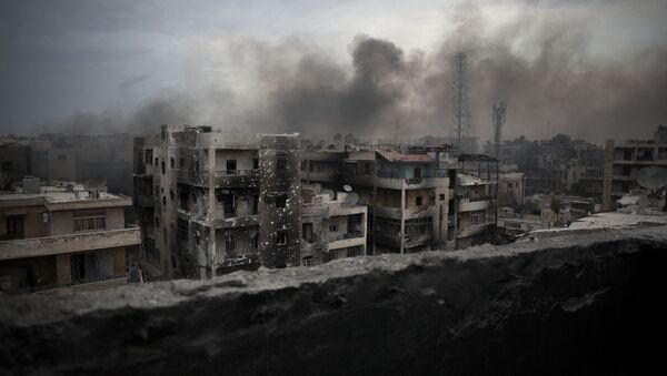 In this Tuesday, Oct. 2, 2012 file photo, smoke rises over Saif Al Dawla district, in Aleppo, Syria - Sputnik International