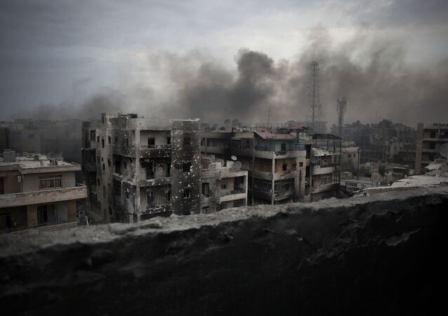 A file photo of smoke rising over Saif Al Dawla district, in Aleppo, Syria