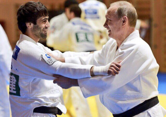 Gold Medalist Beslan Mudranov Spars With Russian President Vladimir Putin