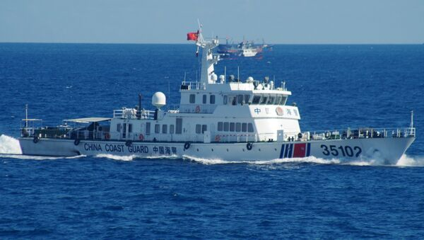 In this photo released by the 11th Regional Coast Guard Headquarters of Japan, a Chinese coast guard vessel sails near disputed East China Sea islands Saturday, Aug. 6, 2016 - Sputnik International