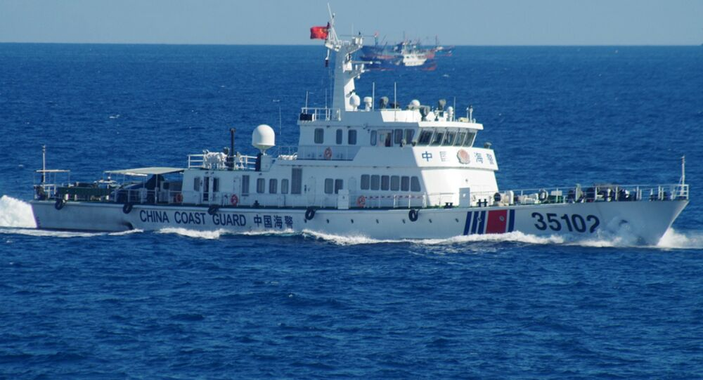 In this photo released by the 11th Regional Coast Guard Headquarters of Japan, a Chinese coast guard vessel sails near disputed East China Sea islands Saturday, Aug. 6, 2016