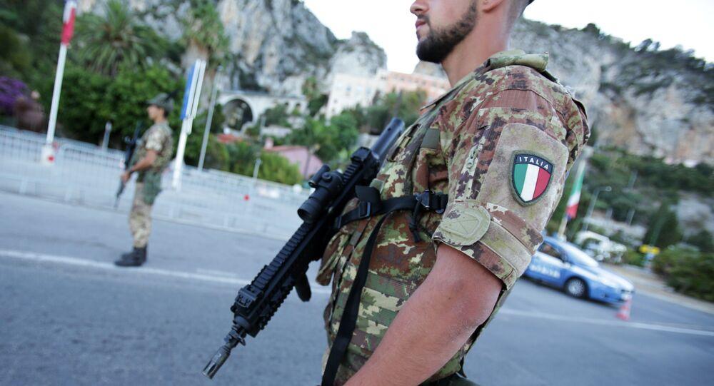 Italian servicemen stand guard and check vehicles at the Italian-French border in Ventimiglia, Italy (File)