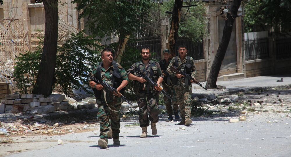 Syrian army soldiers patrol a street in government-controlled Aleppo's al-Khalidiya area (File)