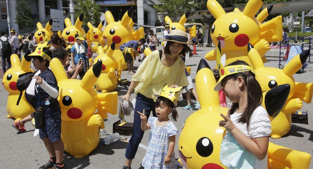 Visitors walk past Pokemon characters in Yokohama, near Tokyo