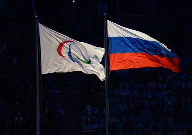 The Paralympic flag and the Russian national flag