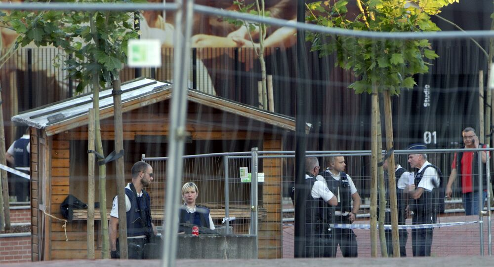 Police and investigators work at the scene of an attack at the police headquarters in Charleroi, Belgium on Saturday, Aug. 6, 2016.