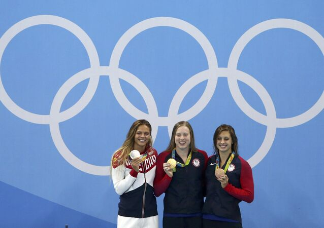 Lilly King (USA) of USA, Yulia Efimova (RUS) of Russia and Katie Meili (USA) of USA pose with their medals