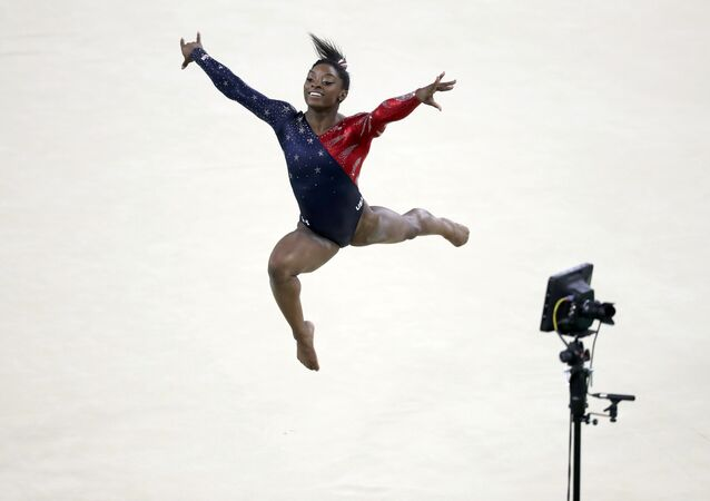 2016 Rio Olympics - Artistic Gymnastics - Preliminary - Women's Qualification - Subdivisions - Rio Olympic Arena - Rio de Janeiro, Brazil - 07/08/2016. Simone Biles (USA) of the U.S. competes on the floor exercise during the women's qualifications