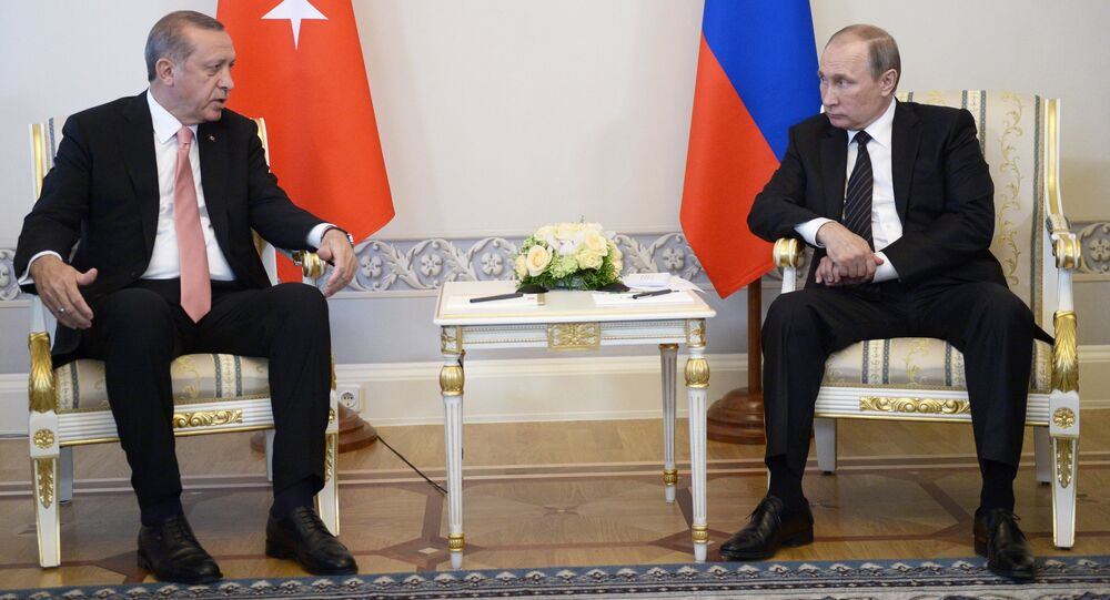 From right: Russian President Vladimir Putin meets with Turkish President Recep Tayyip Erdogan at the Constantine Palace