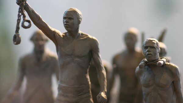 A maquette of a statue commemorating the enslaved Africans whose lives were lost during the slave trade is pictured as it is unveiled by London Mayor Boris Johnson in central London, on August 18, 2008. The statue is to be erected in Hyde Park - Sputnik International