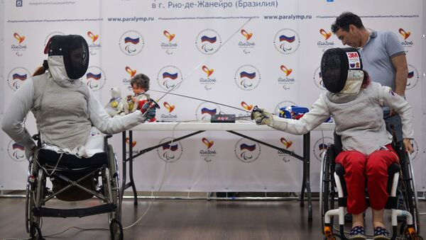 Kseniya Ovsyannikova (right) and Anna Petukhova, members of the Russian wheeled fencing team, attending a press conference on Paralympic Games in Rio de Janeiro - Sputnik International