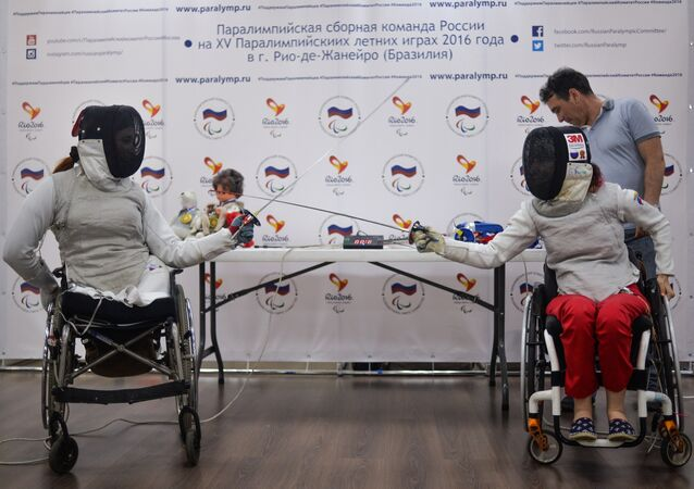 Kseniya Ovsyannikova (right) and Anna Petukhova, members of the Russian wheeled fencing team, attending a press conference on Paralympic Games in Rio de Janeiro
