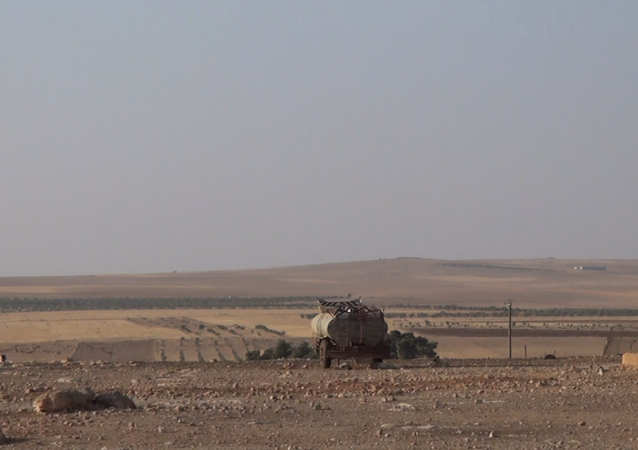 The moment of combustion of heavy equipment to Islamic state after Syrian shelling