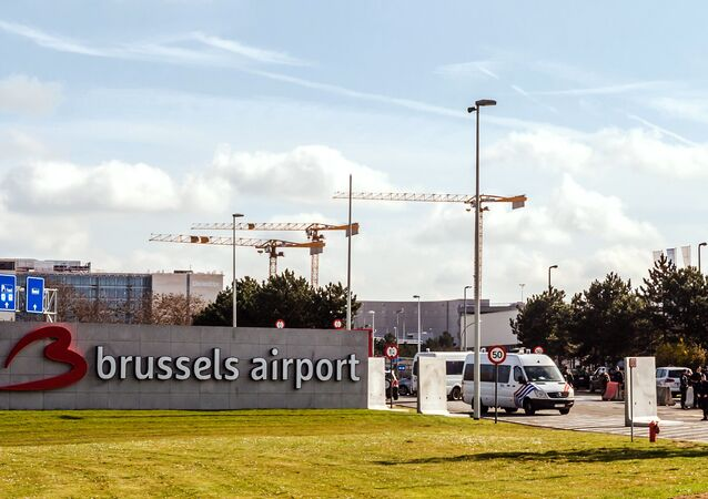 Police guard the entrance road at Brussels Airport, in Zaventem, Belgium