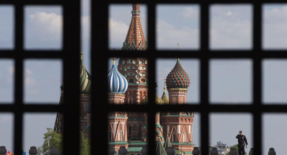 policeman walks on the Red Square near the St Basil 's Cathedral on May 6, 2016 in Moscow