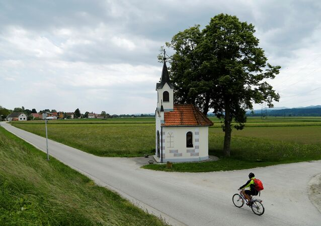 A person cycles along a street in Brezice, Slovenia, May 23, 2016