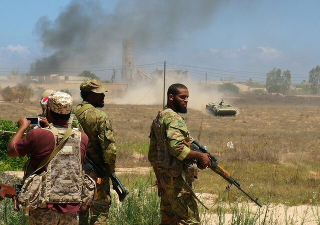 Libyan forces allied with the U.N.-backed government prepare to capture university buildings during a battle with IS fighters in Sirte, Libya, August 10, 2016