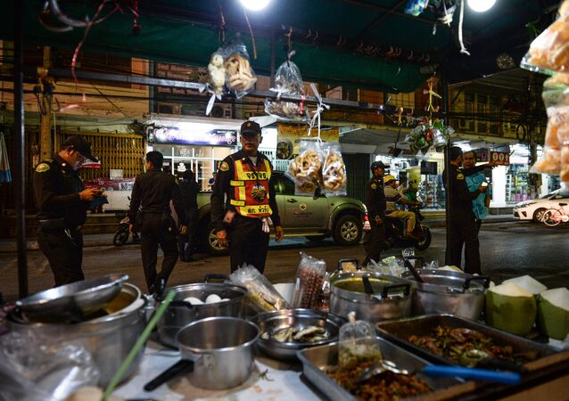 Police inspect a near-empty parking lot where the popular and busy night market should have been held in the upscale resort town of Hua Hin on August 12, 2016