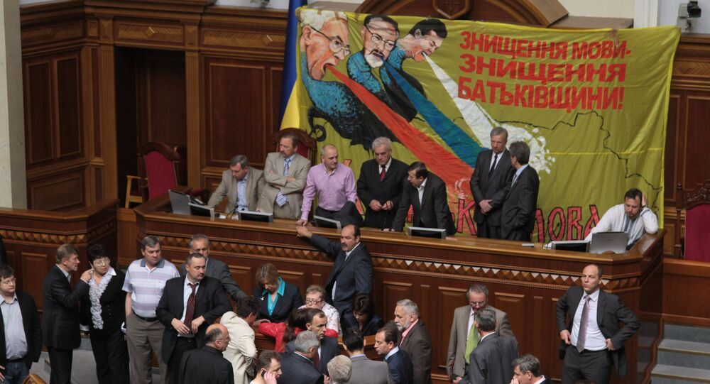 Deputies of opposition factions block the Presidium of the Verkhovna Rada demanding that the parliament not discuss a bill that would give the Russian language official status in Ukraine