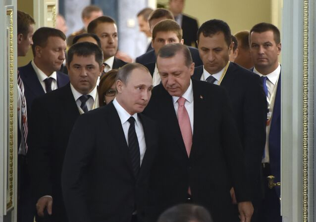 Russian President Vladimir Putin (C-L) and his Turkish counterpart Recep Tayyip Erdogan (C-R) enter a hall to start their meeting with Russian and Turkish entrepreneurs in Konstantinovsky Palace outside Saint Petersburg on August 9, 2016