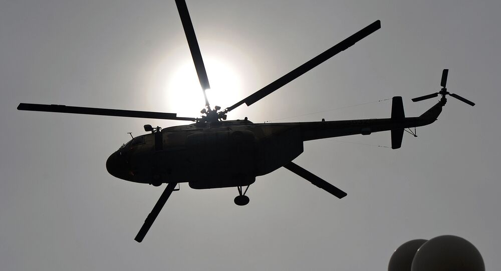 This file photo taken on March 23, 2014 shows a Pakistani Air Force Mi-17 helicopter flies over the Presidential Palace during a parade marking the country's National Day in Islamabad