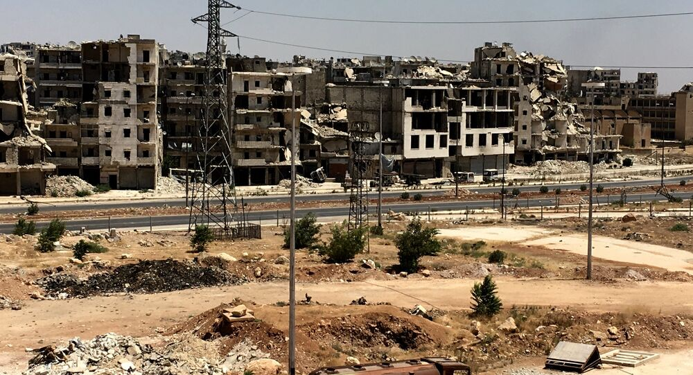 Damaged buildings in Al-Ramouseh district in southern Aleppo