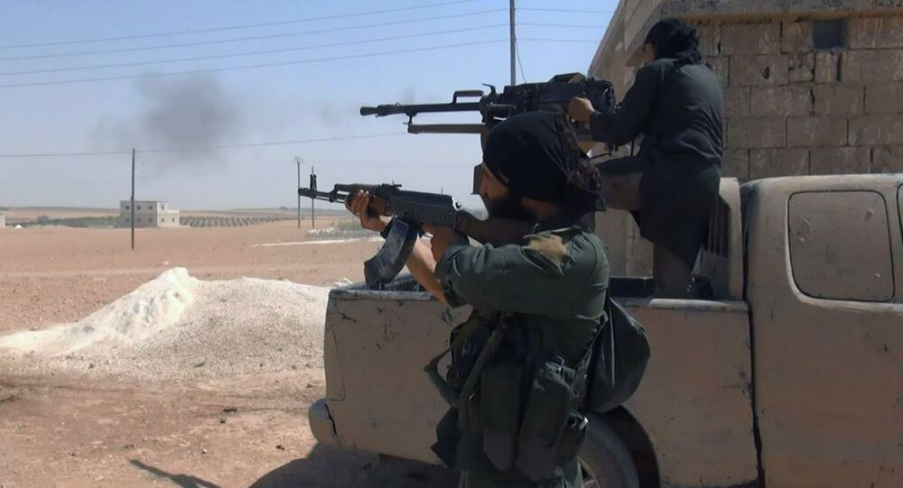Islamic State fighters fire their weapons during clashes with the Kurdish-led Syria Democratic Forces in Manbij, in Aleppo province, Syria (File)