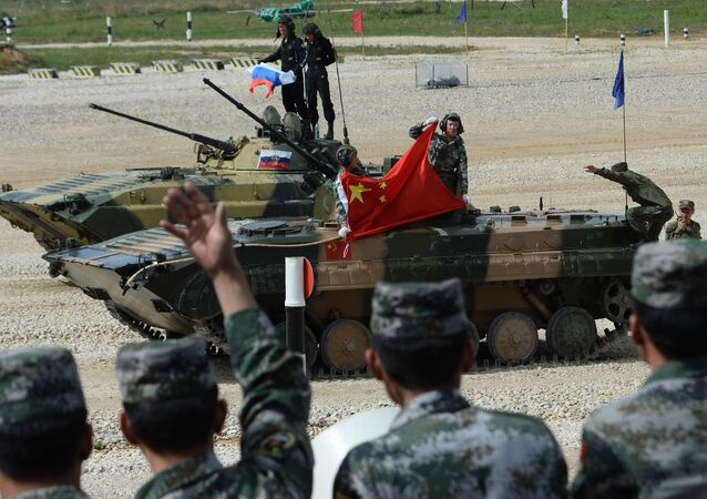 China's BMP-2 crew which took a second place the final contest of the Suvorovsky Natisk (Suvorov Onslaught) competition at the Alabino training ground in the Moscow Region. Background: Russia's BMP-2 crew which won the final contest of the Suvorovsky Natisk (Suvorov Onslaught) competition at the Alabino training ground in the Moscow Region