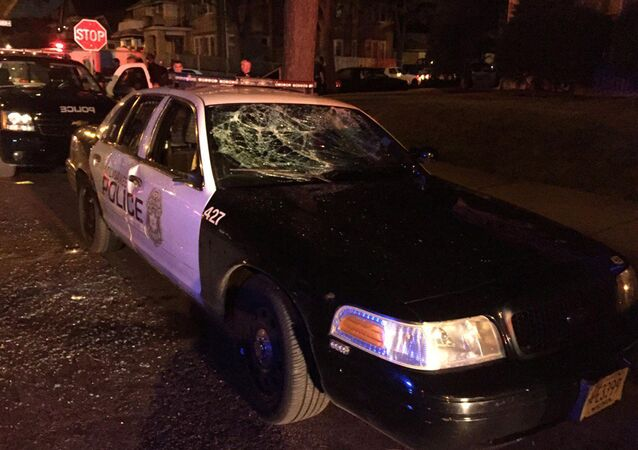 A police car with broken windows is seen in a photograph released by the Milwaukee Police Department after disturbances following the police shooting of a man in Milwaukee, Wisconsin, U.S. August 13, 2016