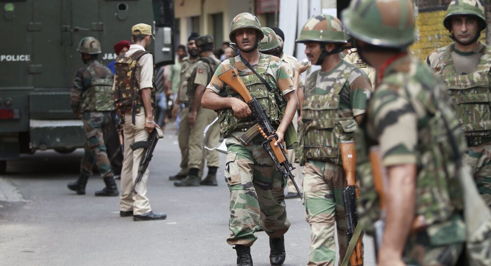 Indian army soldiers search for suspected militants