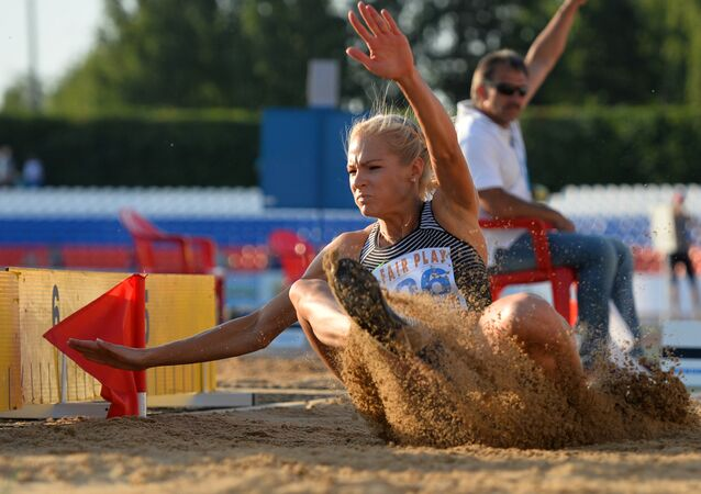 Darya Klishina competes in the long jump event at the Russian Track and Field Athletics Championship in Cheboksary.