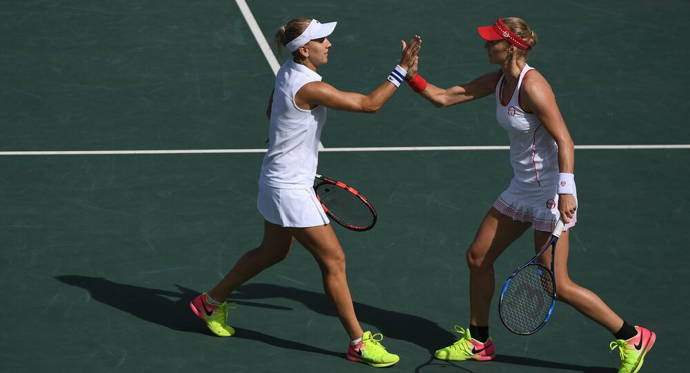 Russian athletes Elena Vesnina (left) and Ekaterina Makarova during the semifinals match of the women's doubles tennis against Lucie Safarova and Barbora Strycova (Czech Republic) at the XXXI Summer Olympics