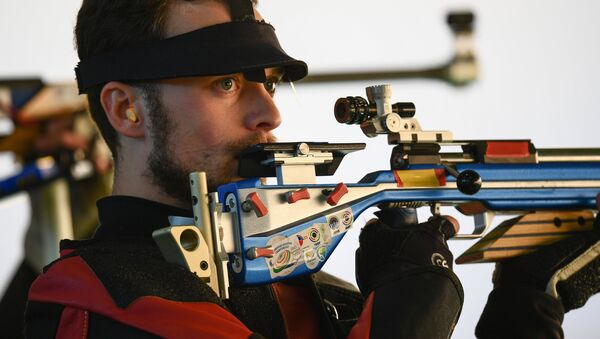 Sergei Kamensky (Russia) during the qualifying round of the men's 50m rifle 3 positions event at the XXXI Summer Olympics - Sputnik International