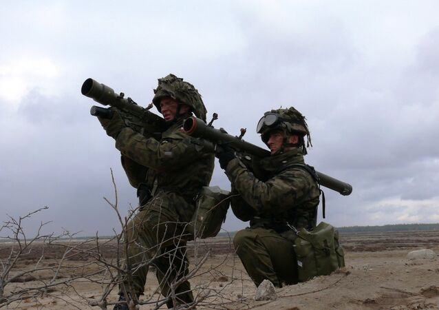 Polish soldiers practice taking aim with Grom MANPADs
