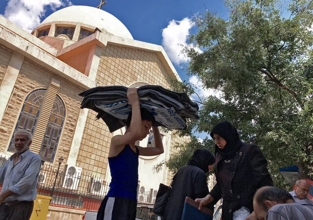 Refugees from block 1070 in south-western Aleppo who received aid in a Sunday Orthodox School by an Orthodox church in Aleppo