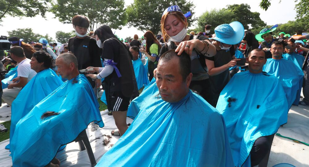 More than 900 Seongju residents have their heads shaved during a protest against the planned deployment of the US Terminal High Altitude Area Defense (THAAD) system at a local park in the southeastern town of Seongju on August 15, 2016