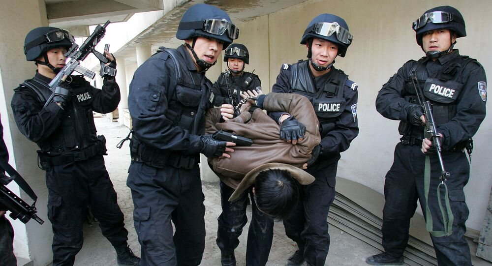 Members of the Special Weapons and Tactics Team (SWAT) of the Xian police force arrest a 'terrorist' during a drill at the Qujiang Waterworks in Xian, northwestern China's Shaanxi province. file photo